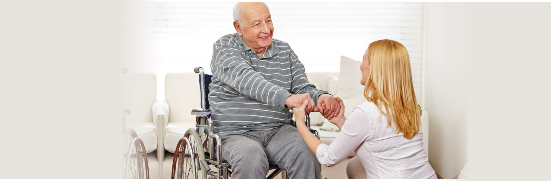 passionate caregiver holding the hands of an old man